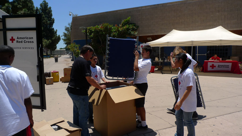 Youth Packing up Cots in San Diego